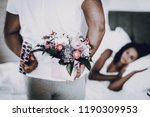 a man is making a gift to... | Shutterstock . vector #1190309953