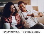 afro american couple drinking...   Shutterstock . vector #1190312089