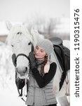beautiful girl in a gray vest... | Shutterstock . vector #1190315476