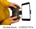 game pad with smartphone in... | Shutterstock . vector #1190317576