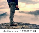 photographer hand with  camera  ... | Shutterstock . vector #1190328193