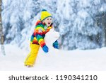 kid making snowman in snowy... | Shutterstock . vector #1190341210
