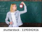 woman teacher hold alarm clock. ... | Shutterstock . vector #1190342416