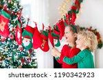 kids opening christmas presents....   Shutterstock . vector #1190342923