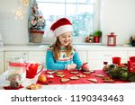 kids bake christmas cookies.... | Shutterstock . vector #1190343463