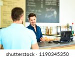 barista handsome stylish... | Shutterstock . vector #1190345350