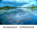 cloudy sky over the lake. rainy ... | Shutterstock . vector #1190361646