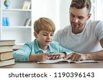 the happy father and a son... | Shutterstock . vector #1190396143