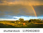 rainbow in the sky over a rural ... | Shutterstock . vector #1190402803
