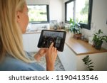 woman at home using smart... | Shutterstock . vector #1190413546