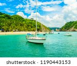 sailboat in a tropical harbor... | Shutterstock . vector #1190443153