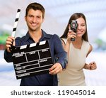 man holding clapper board and... | Shutterstock . vector #119045014