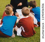 kids football team with coach... | Shutterstock . vector #1190456506