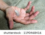 a light feather on the hand of... | Shutterstock . vector #1190468416