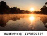 View Of River In The Mist At...