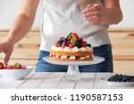 young female pastry chef... | Shutterstock . vector #1190587153