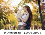 young modern happy mom with... | Shutterstock . vector #1190668936