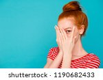 Stock photo portrait of nice cute attractive magnificent lovely cheerful red haired girl with bun hiding face 1190682433