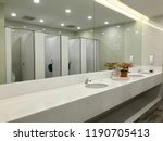 row of wash sink with big... | Shutterstock . vector #1190705413