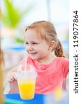 Portrait of cute little girl at outdoor restaurant - stock photo