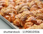 fresh croissant with nuts in... | Shutterstock . vector #1190810506