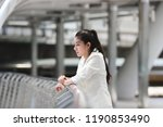 depressed stressed young asian... | Shutterstock . vector #1190853490