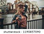 seductive girl is standing on...   Shutterstock . vector #1190857090