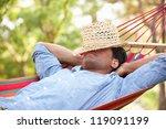 man relaxing in hammock | Shutterstock . vector #119091199