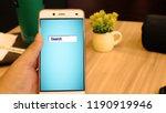 hand using smartphone in coffee ... | Shutterstock . vector #1190919946