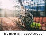 padel blade racket resting on... | Shutterstock . vector #1190930896