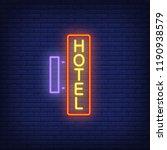 hotel neon signboard on brick... | Shutterstock .eps vector #1190938579