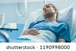 in the hospital sick male... | Shutterstock . vector #1190998000