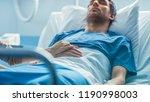 in the hospital sick man lying...   Shutterstock . vector #1190998003
