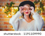 portrait of a young cozy woman...   Shutterstock . vector #1191109990