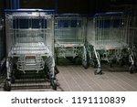 metal trolleys at supermarket... | Shutterstock . vector #1191110839