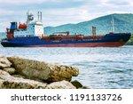 cargo ship in the sea  close up   Shutterstock . vector #1191133726