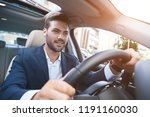 portrait of joyful man driving... | Shutterstock . vector #1191160030