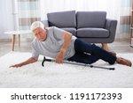 senior man fallen on carpet... | Shutterstock . vector #1191172393