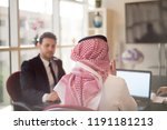 saudi business  hands signing a ... | Shutterstock . vector #1191181213
