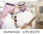 saudi business  hands signing a ... | Shutterstock . vector #1191181270