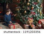 beautiful baby boy on christmas ...   Shutterstock . vector #1191203356