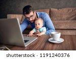 young businessman using a... | Shutterstock . vector #1191240376