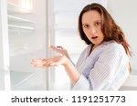 young girl spread her hands to... | Shutterstock . vector #1191251773