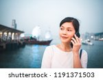 woman use smartphone in hong... | Shutterstock . vector #1191371503
