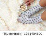 woman feet in polka dot socks... | Shutterstock . vector #1191404800