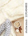 woman feet in polka dot socks... | Shutterstock . vector #1191404803