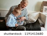 grandfather and grandson using... | Shutterstock . vector #1191413680