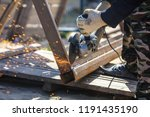 sparks from cutting metal on... | Shutterstock . vector #1191435190