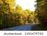 the road through the autumn...   Shutterstock . vector #1191479743