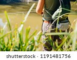 spin fishing on a river with rod | Shutterstock . vector #1191481756